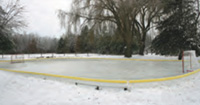 A backyard ice rink surrounded by a sideboard